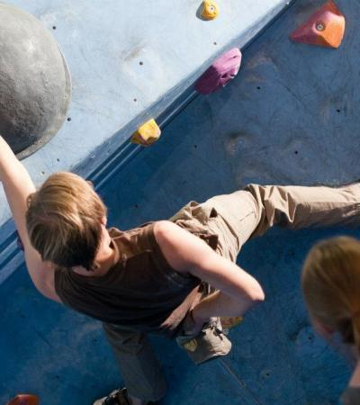 Person bouldering at Nottingham Climbing Centre