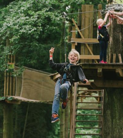 Boy on zip wire at Go Ape Woburn