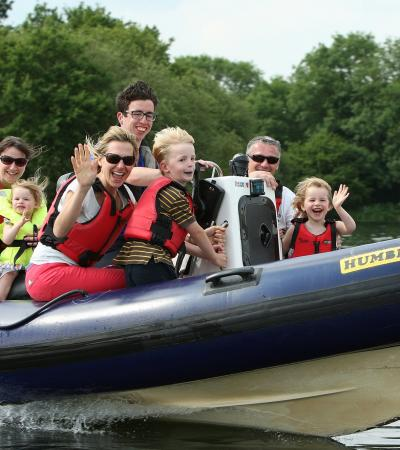 Kids on boat at Dinton Pastures Country Park in Wokingham