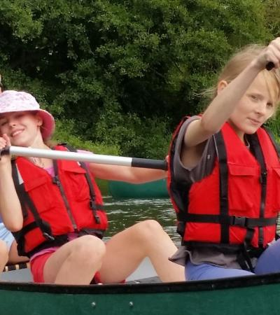 Girls canoeing at Nene Extreme Adventures in Oundle