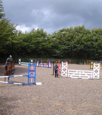 Horse and rider jumping at Dean Riding Stables in Parracombe