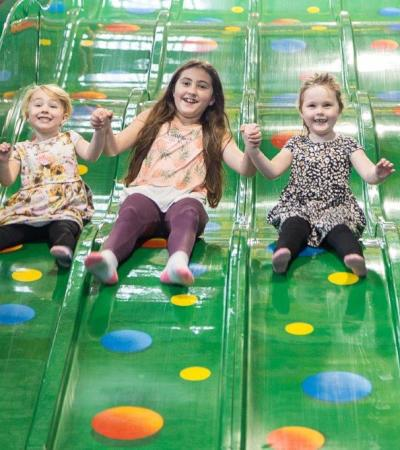 Kids on slide at Kidz About Adventure Play in Swindon