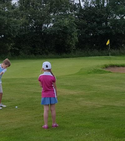Kids playing golf at Stonham Barns Crazy Golf in Aspall