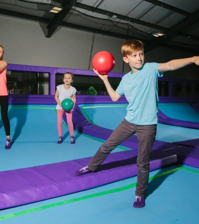 Kids playing dodgeball at Rebound Ashby Trampoline Park in Ashby-de-la-Zouch