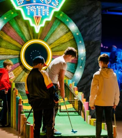 A group of kids playing golf at Treetop Adventure Golf in Leicester
