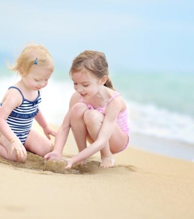 Kids Playing in the sand on the beach