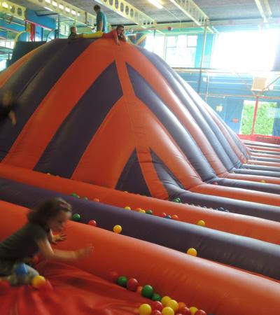 Kids sliding on inflatable at Kids Kingdom in Southend on Sea