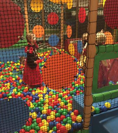 Girls in ball pit at Crazy Tots Soft Play in Leatherhead