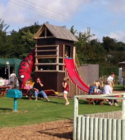 Families playing on outdoor playground at Jungle Jims in Birchington