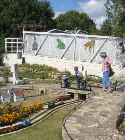 Family looking at miniature village at Railworld in Peterborough