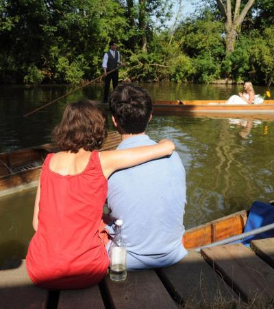 Visitors relaxing and rowing at Cherwell Boat House in Oxford