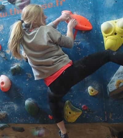 Woman on climbing wall at The Climbing Works in Sheffield