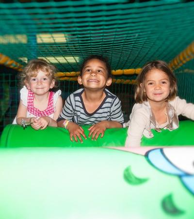 Kids in soft play frame at MB's Funhouse in Hemsby