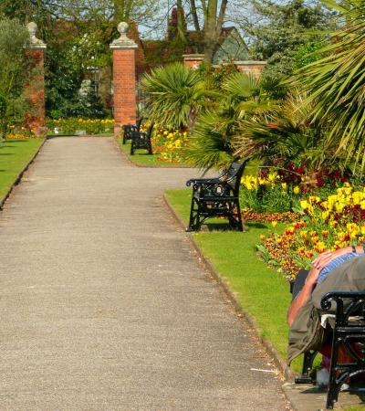 Man resting in gardens at Castle Park and Gardens in Colchester
