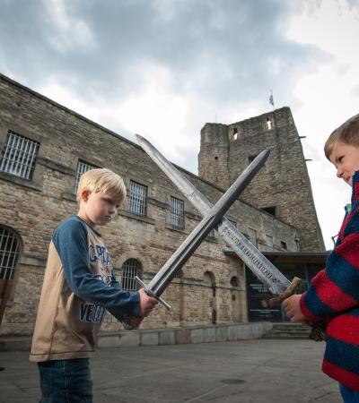 Boys sword fighting at Oxford Castle Unlocked