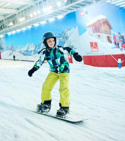 Girl snowboarding at The Snow Centre in Hemel Hempstead