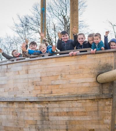 Kids on wooden boat at Bewl Water in Lamberhurst