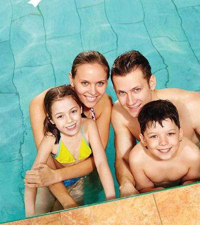 Family in swimming pool at Kingsmead Leisure Centre in Canterbury