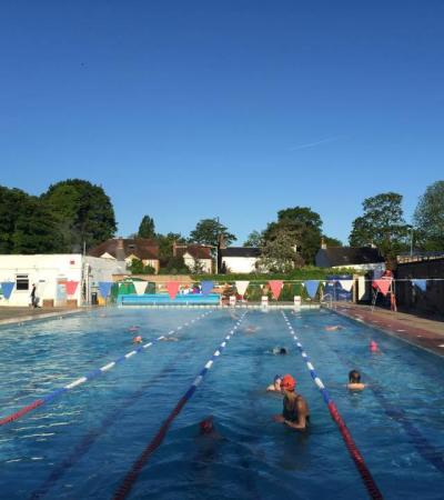 People in outdoor swimming pool at Hampton Pool