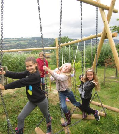 Girls on swings at Bath City Farm