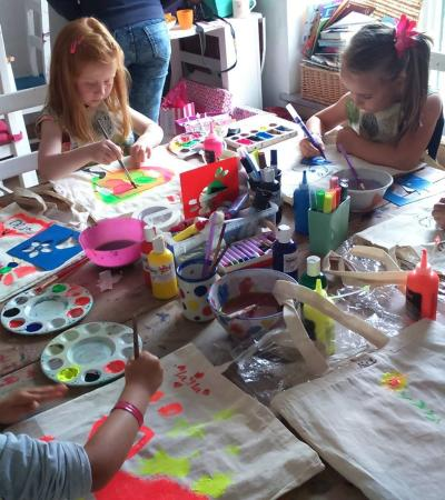 Girls painting at Potter Around in Kirknewton