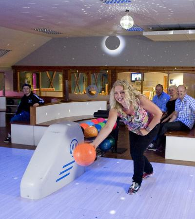 Woman bowling at Richardsons Family Entertainment Centre in Lowestoft