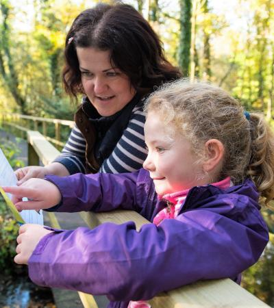 Mum and daughter with map at Fairhaven Woodland and Water Garden in South Walsham
