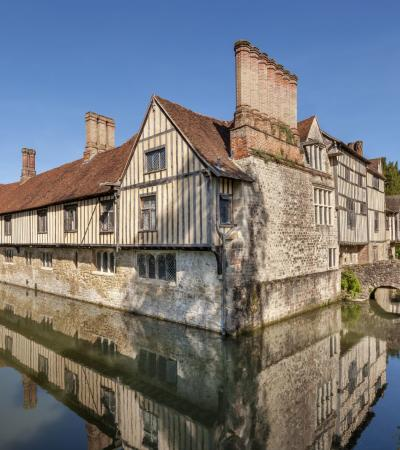 An overview of Ightham Mote on a sunny day