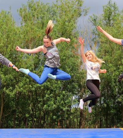 Girls on jump pillow at Skylark Maize Maze and Funyard in March