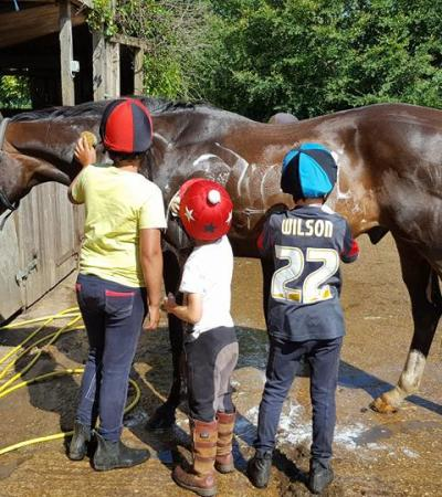 Kids washing horse at Brook House Farm in Louth