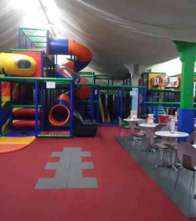 Indoor soft play frame and seating area at Stay and Play Basildon in Laindon