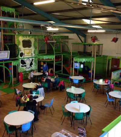 Indoor soft play frame and cafe area at Treetops Soft Play in Ely
