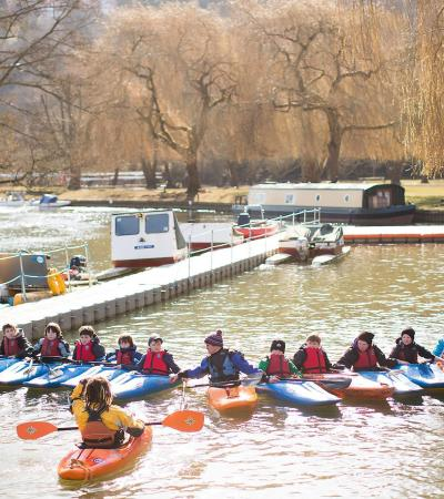 Kids and instructors in kayaks at Longridge Activity Centre in Marlow