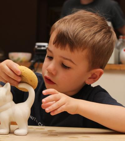 Boy washing pottery piece at Creative Biscuit Ceramics Cafe in South Woodford