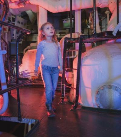 A little girl walking around HMS Belfast in London