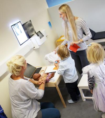 Kids at a role play doctor's office at Tots Town in Norwich