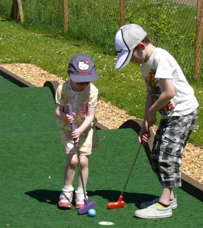 Kids playing mini golf at Eaton Park Crazy Golf in Norwich