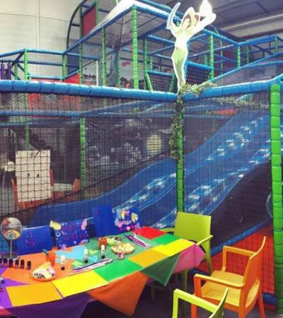 Face painting station and slide at Kidz Fantasy Land in Liverpool