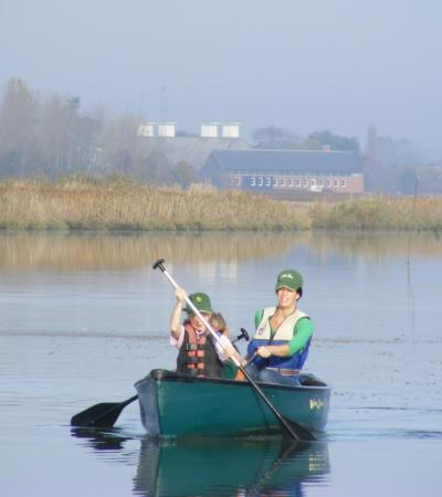 Mum and son on canoe at Iken Canoe in Woodbridge