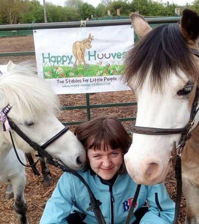 Staff with ponies at Happy Hooves Stables in Bedford