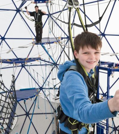Boy on high rope course at The SFEAR in Milton Keynes