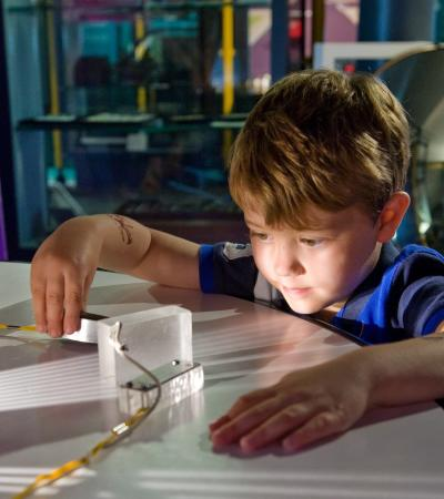 Boy exploring at Discovery Museum in Newcastle upon Tyne
