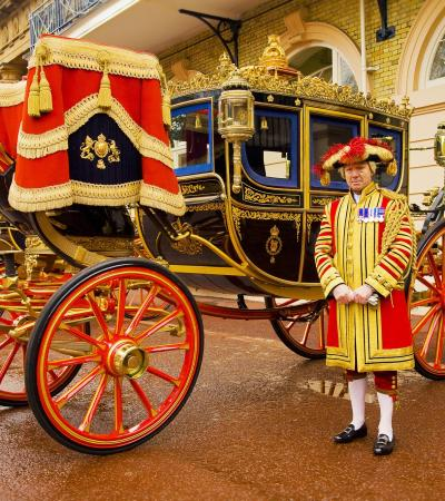 Guard by Diamond Jubilee State Coach at The Royal Mews in London