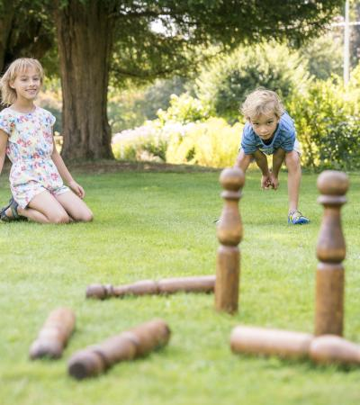 Two kids playing garden games at Jane Austen's House in Hampshire