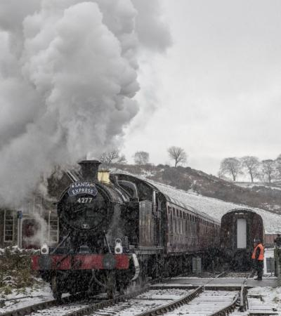 The Santa Express in the snow at Churnet Railway Station