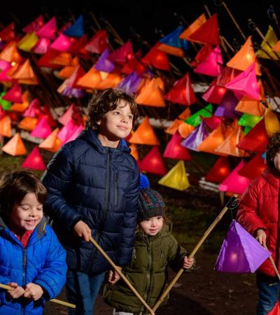 A group of kids holding lanterns at Wakehurst Gardens Glow Wild Trail