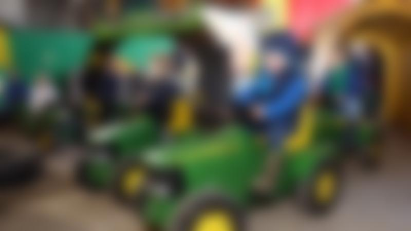 Boys in Young Tractor Drivers Challenge at Cantref Adventure Farm in Brecon