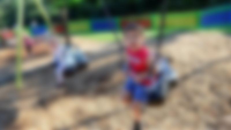 Kids on swings at Roker Park in Sunderland