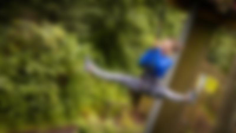 Girl doing a zip wire at Go Ape Peebles