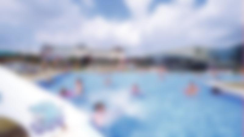 Families swimming at Embassy Outdoor Swimming Pool in Skegness